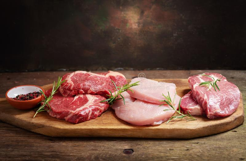 Various types of fresh meat steaks: beef, pork and turkey royalty free stock photo