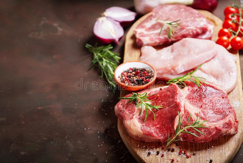 Various types of fresh meat steaks: beef, pork and turkey royalty free stock image