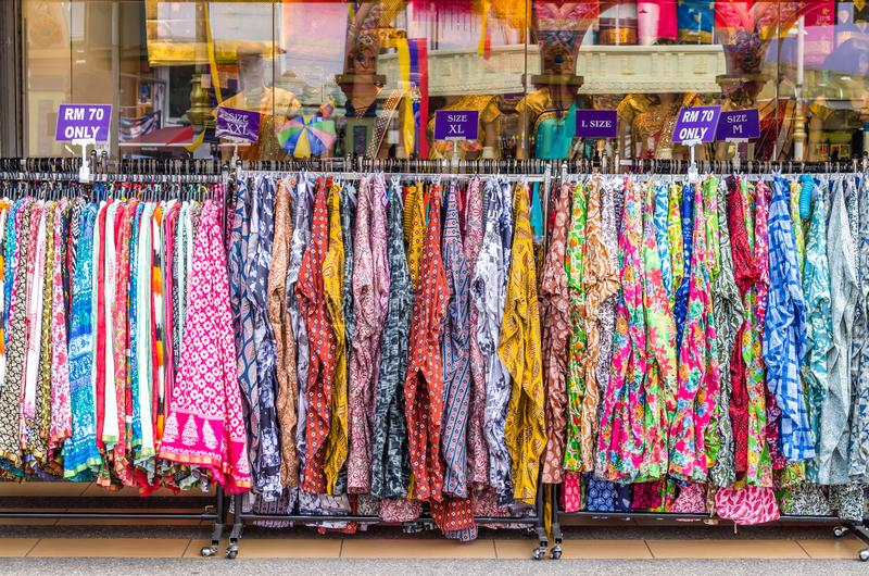 Various types of Indian fashion clothes displaying and selling in front of retail shop. Or store royalty free stock image