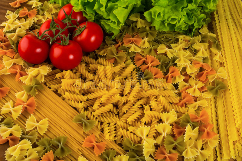 Various types of Italian pasta background stock photos