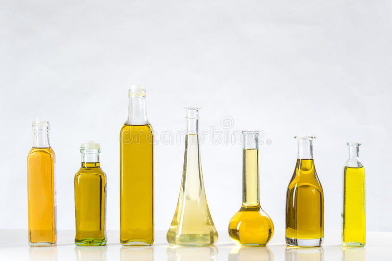 Various types of oil in bottles. Different sorts of cooking oil close-up stock photos