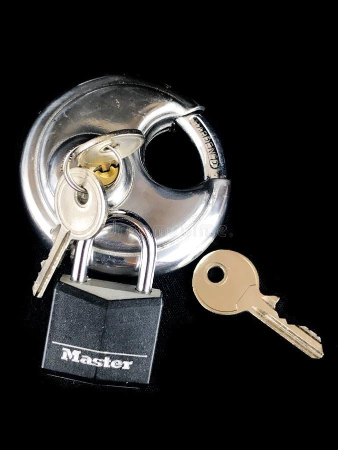 Various Types of Pad Locks and Keys. On a black backdrop royalty free stock photo