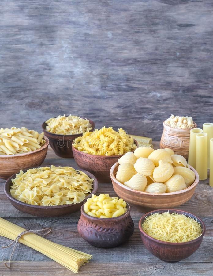 Various types of pasta. On rustic background royalty free stock images