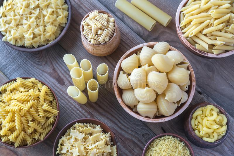 Various types of pasta. On rustic background royalty free stock image