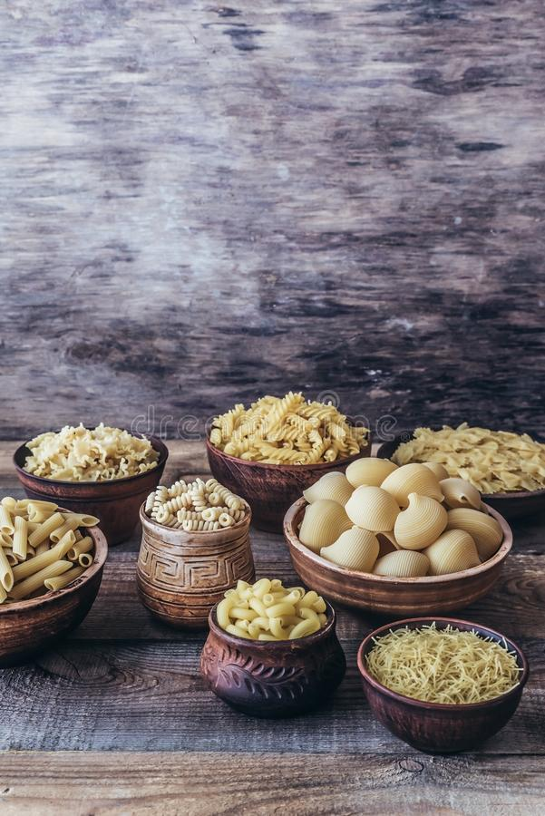 Various types of pasta. On rustic background royalty free stock photography