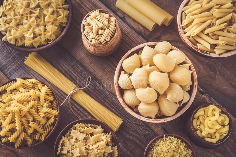 Various types of pasta. On rustic background stock image