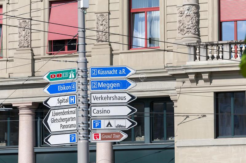 Various types of signposts in Lucerne royalty free stock photography