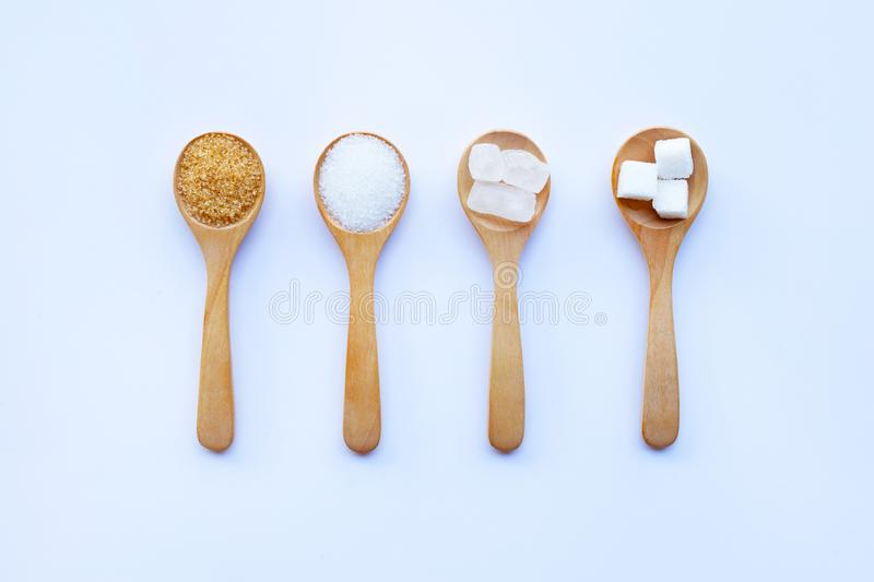 Various types of sugar on white background stock photography