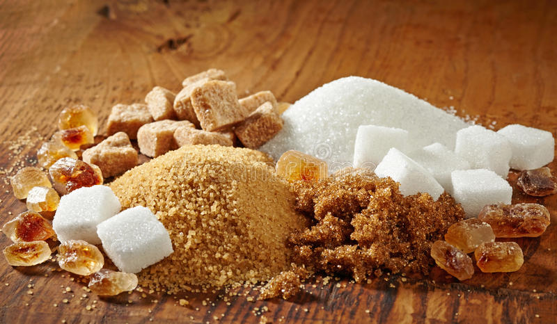 Various types of sugar. On wooden table royalty free stock photos