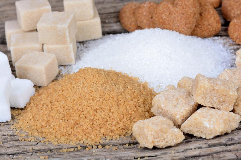 Various types of sugar on wooden table royalty free stock image