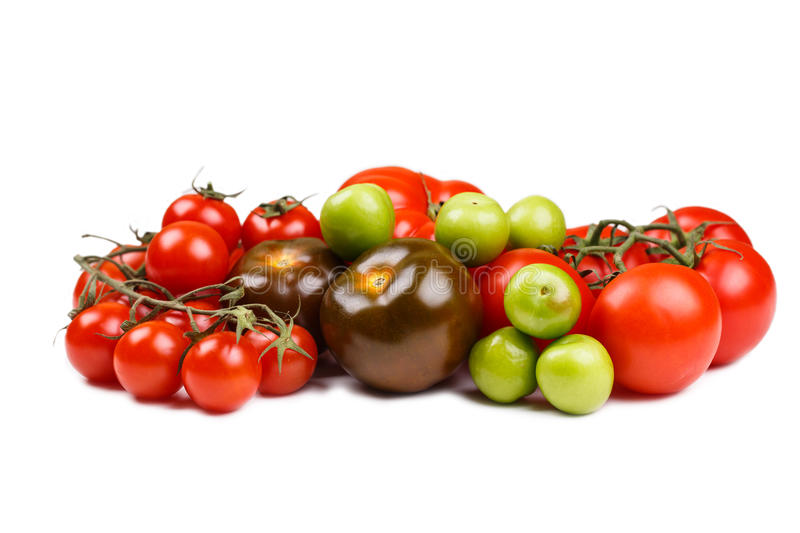 Various types of tomatoes on the table.  royalty free stock images
