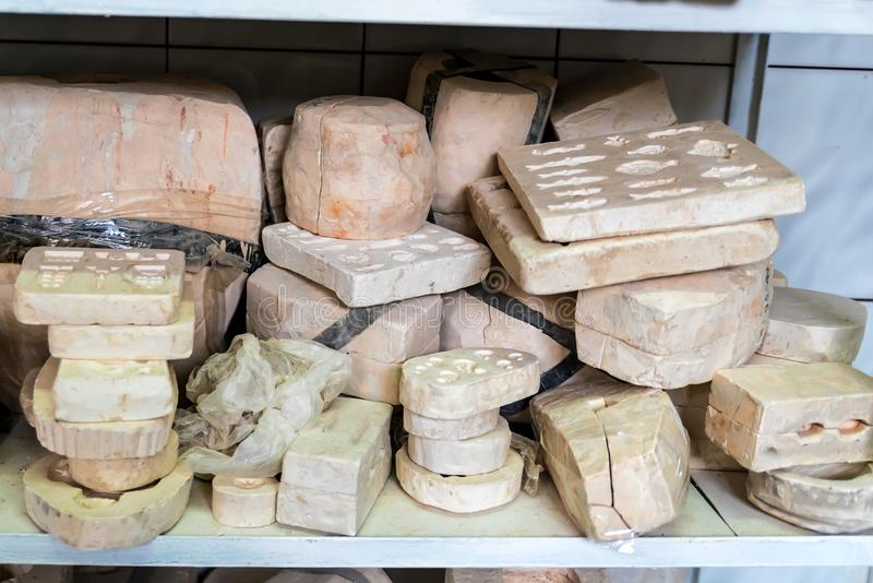 Various unpainted clay items on shelf royalty free stock photo