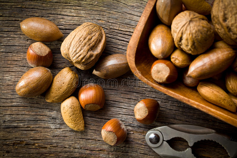 Various Unpeeled Nuts In Wooden Bowl Royalty Free Stock Image