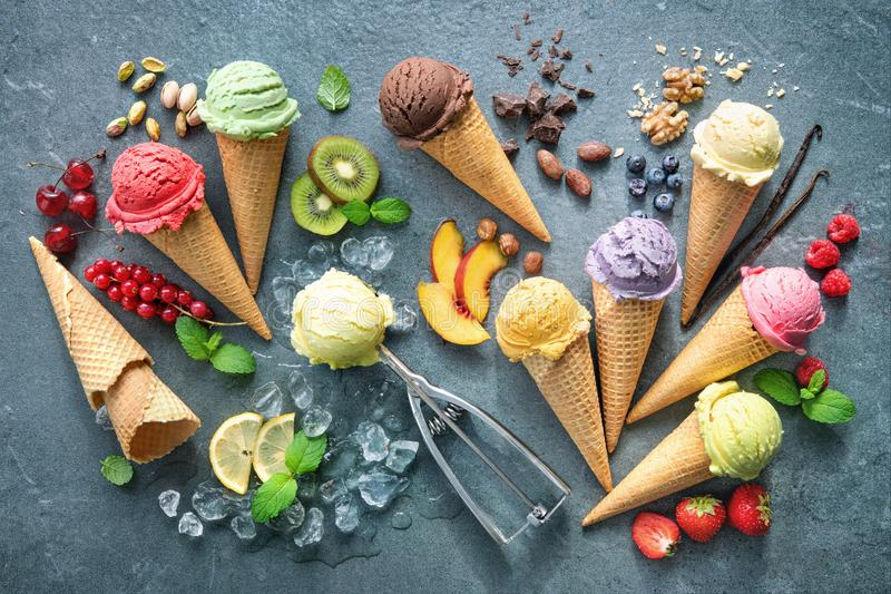 Various varieties of ice cream in cones royalty free stock photography