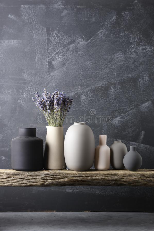 Various vases on wooden shelf stock photography