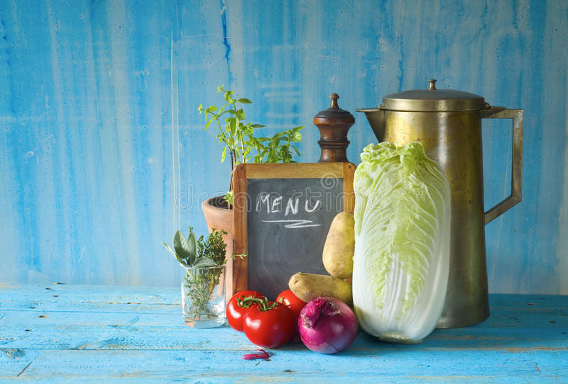 Various vegetables,. Menu black board, kitchen utensils,free copy space royalty free stock photography