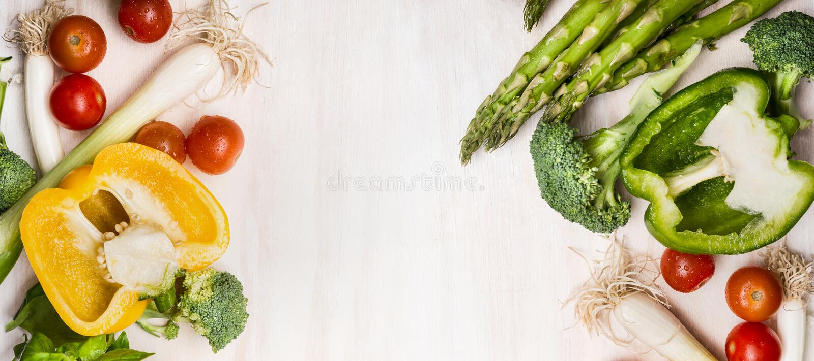 Various vegetables for tasty cooking with asparagus, paprika, tomatoes, broccoli and onions on white wooden background, top view, royalty free stock photos
