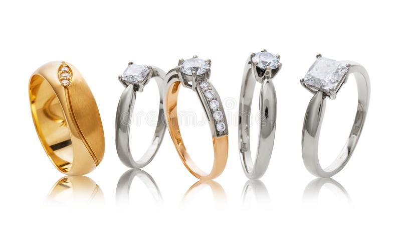 Various wedding gold rings with diamonds isolated royalty free stock photo