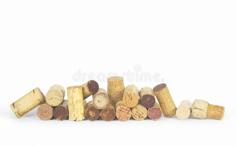 Various wine corks in a row,. White background, free copy space royalty free stock photography