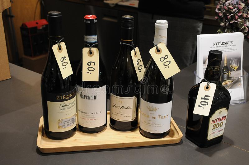 VARIOUS WINE SHOWCASE WITH PRICE TAGS IN WINE BAR. Copenhagen /Denmark/ 27.December 2019/  Various wines showcase with price tags for new years celebrations  on stock photography