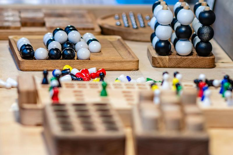 Various wooden toys on the table in craftsmans annual market. Selective focus royalty free stock images