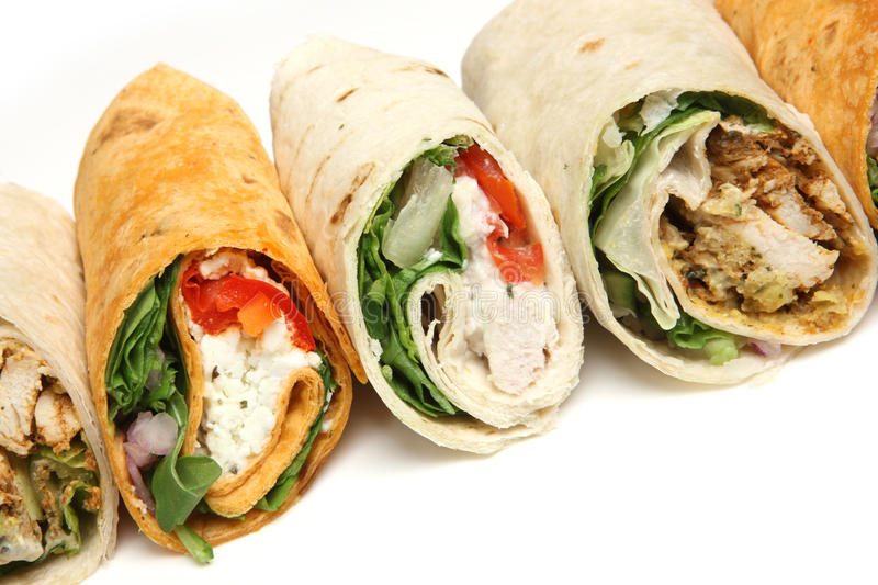 Various Wrap Sandwiches Close Up. Variety of wrap sandwiches with chicken and feta cheese stock images