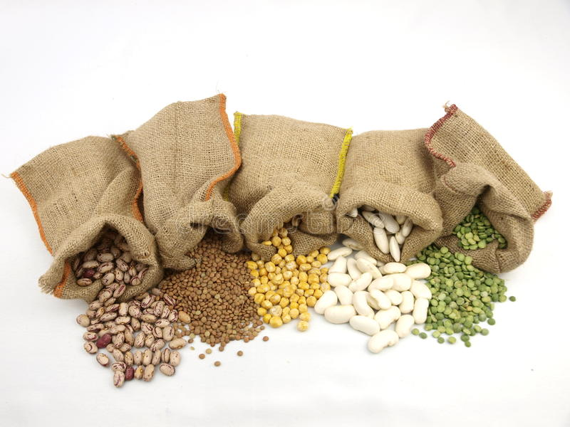 Varius legumes. Burlap sacks with a misc legumes royalty free stock photos