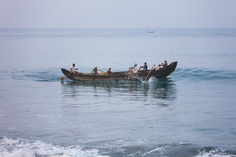 Download Fishermen Sail And Sighting Fish In Traditional Wooden Canoe Boat On Blue Indian Ocean Editorial