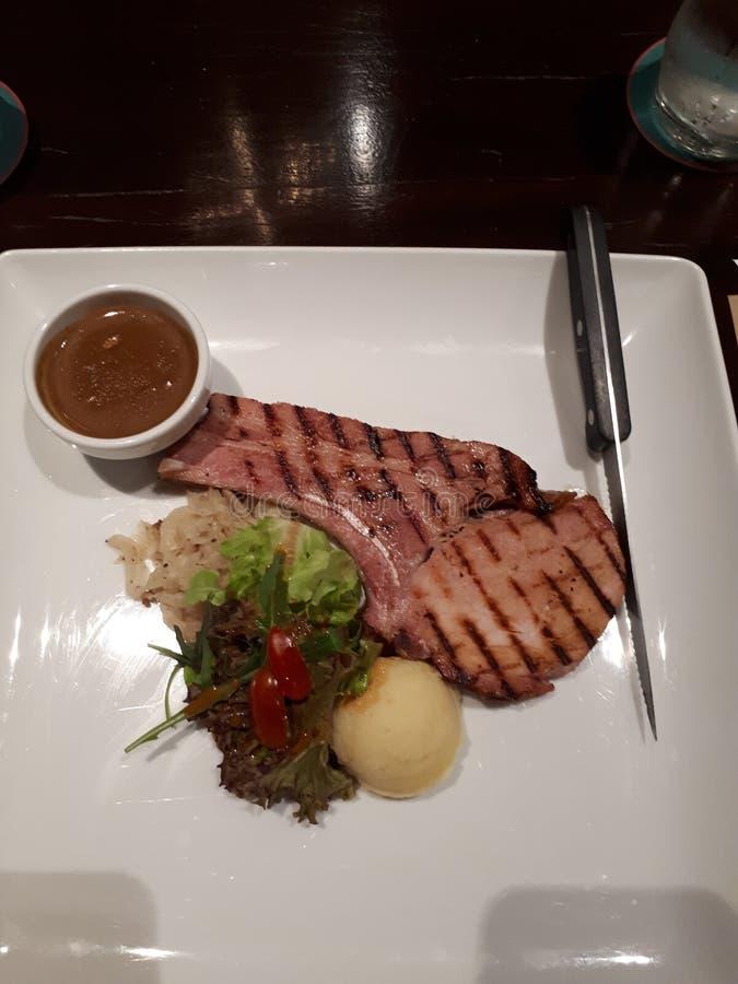 Varkenskoteletlapje vlees stock afbeelding