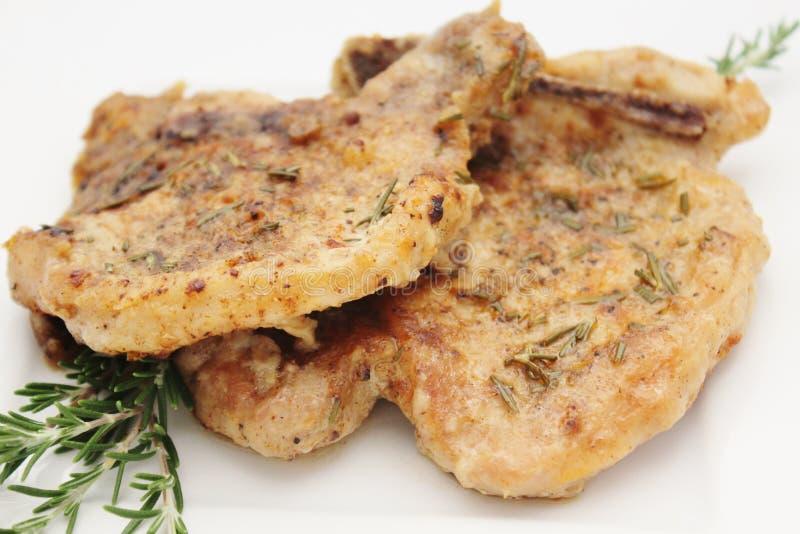 Varkenskoteletten met Rosemary stock fotografie