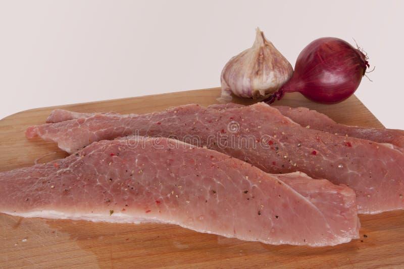 Varkensvlees op een houten raad royalty-vrije stock foto's