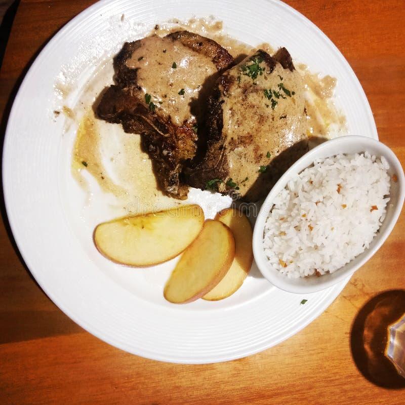 Varkensvleeslapje vlees met rijst stock fotografie