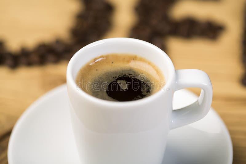 Varm kopp av espressokaffe arkivfoton