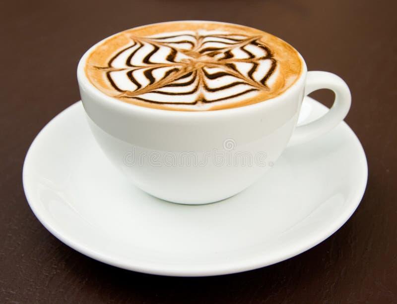 varm latte för konstkaffekopp arkivfoto