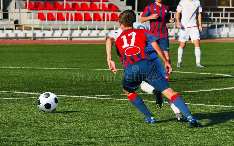 Varma fotbollögonblick arkivfoton
