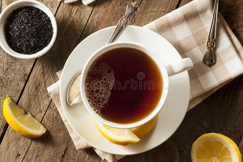 Varmt organiskt svart te royaltyfri fotografi