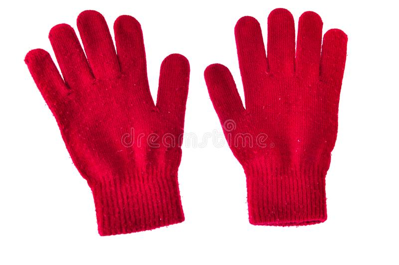 Varmt woolen stack röda handskar som isolerades på den vita bakgrunden arkivfoto