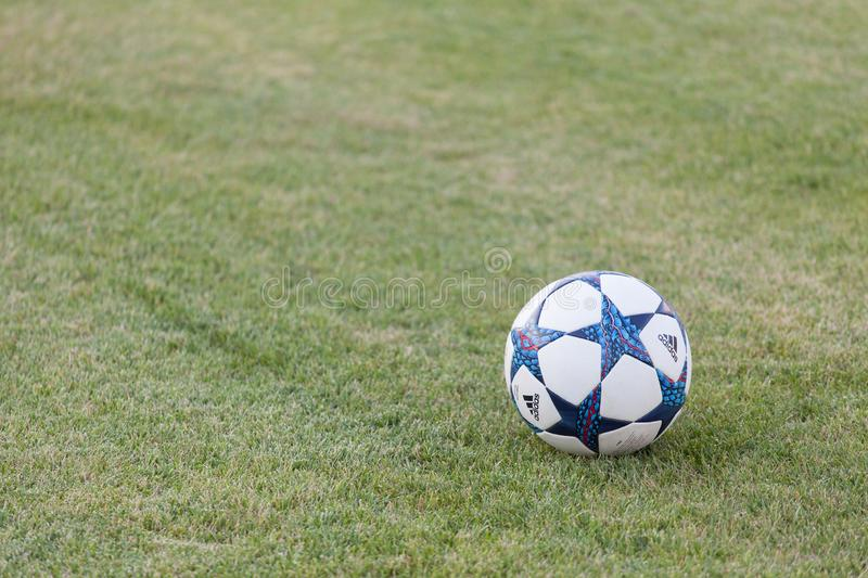 Varna, BULGARIA - AUGUST 11, 2017: Close-up official adidas champions league ball on the grass. Adidas is a German corporation th royalty free stock photography