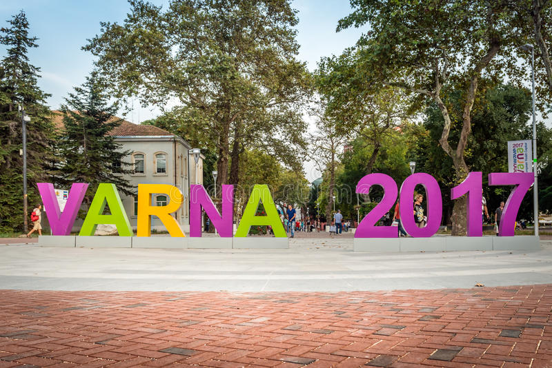 Varna in Bulgaria is 2017 European Youth Capital. Varna,Bulgaria - September 22nd, 2015: People ar walking behind the sign: Varna 2017 The city of Varna ( royalty free stock images