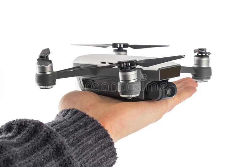 Dji Spark isolated on white and man hand stock photography