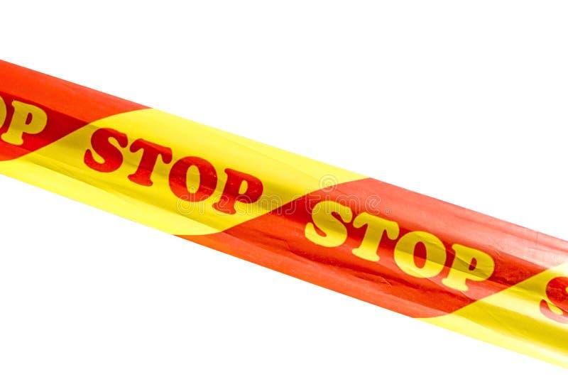 Varningsband med STOPPtecknet som isoleras på vit bakgrund arkivfoton