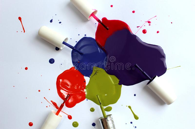 Varnish spilled with tassels of different colors on a white background. Background picture, beauty, blue, bright, brush, collection, color, bright, concept stock photo