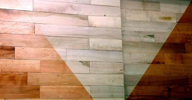 Varnished parquet difference. See the difference between a varnished and unvarnished solid oak flooring royalty free stock images
