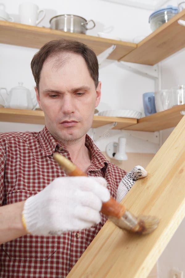 Varnishing wood shelves stock images