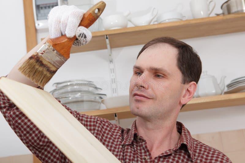 Varnishing wood shelves royalty free stock images