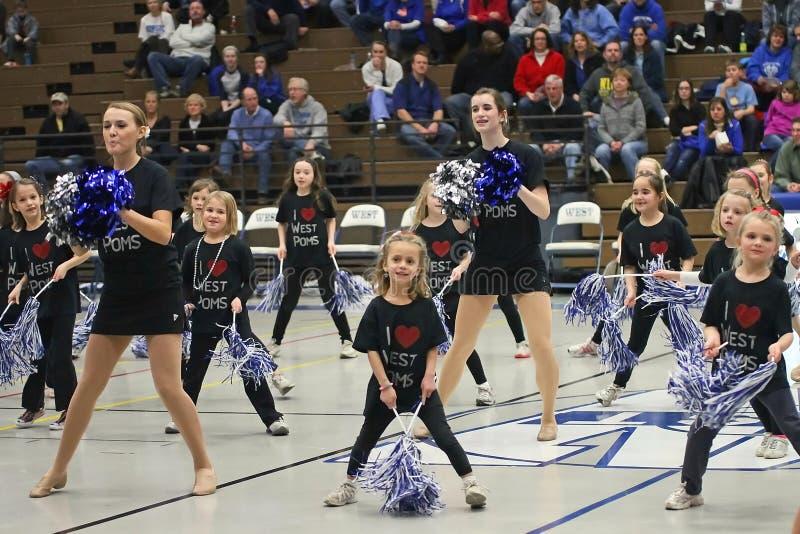 Varsity and Junior Cheerleaders stock images