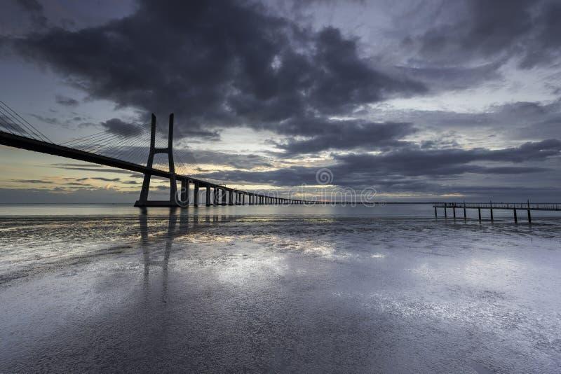 Long bridge over tagus river in Lisbon at sunrise stock photo