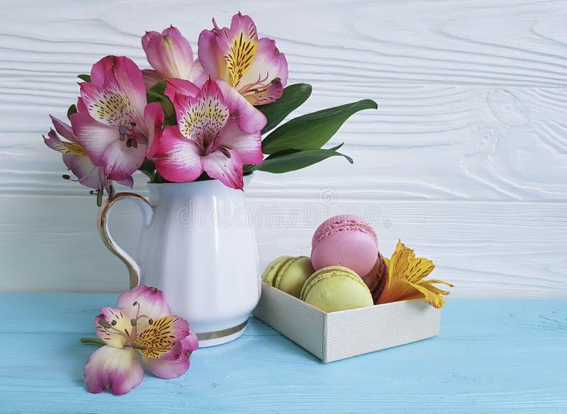Vase alstroemeria flower romancebox macaron colored wooden background, breakfast blue wooden bake royalty free stock images