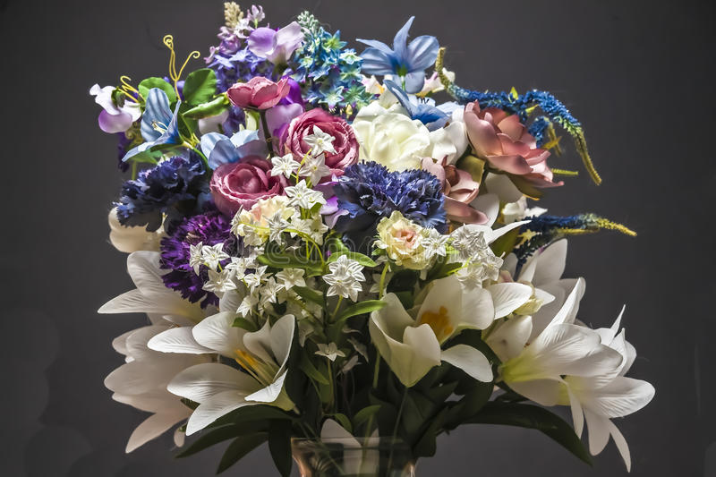 Download Vase Of Artificial Flowers Against Dark Background Stock Image - Image: 49763715