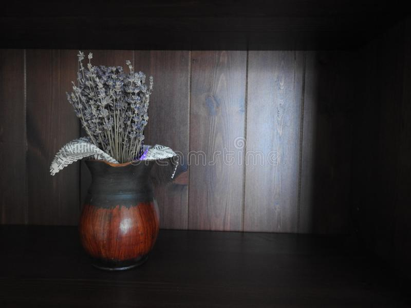 Vase with artificial flowers on wooden background royalty free stock image